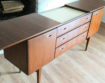 Vintage Mid Century Modern Credenza on tapered legs with concealed serving corral England
