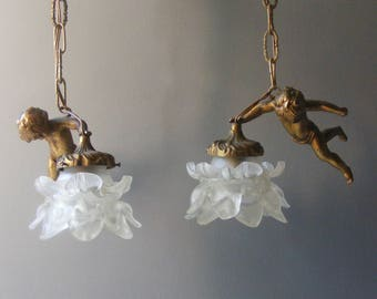 Pair of Antique French Cherub  Suspension Bronze Lamps, Pendant Lights,with  glass shades in the shape of rose.