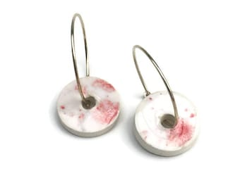 White and red jewelry. Ceramic hoop earring with a retro glaze on a handmade white ceramic bead. Handmade ceramic jewelry with a 925s hoop.