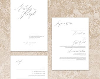 Elegant and simple wedding invitations with minimal styling and matching accessories