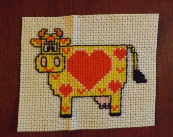 cow heart embroidered on unbleached canvas