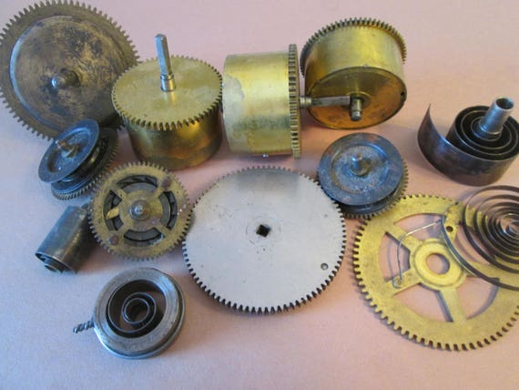 12 Piece Lot of Antique Clock Mainsprings, Grars , and Wheels for your Clock Projects - Steampunk Art - and Etc...