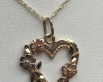 Flowers on a heart 14kt gold pendant