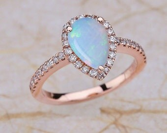 Rose Gold Engagement Ring Pear Shape Opal 14k Center is a 9x6 Pear Shape Opal