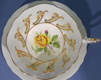 PARAGON Tea Cup and Saucer, Blue and Gold with Yellow Rose Center, Gold Feather Handle, By Appointment to Her Majesty the Queen 1960 ~ 1963