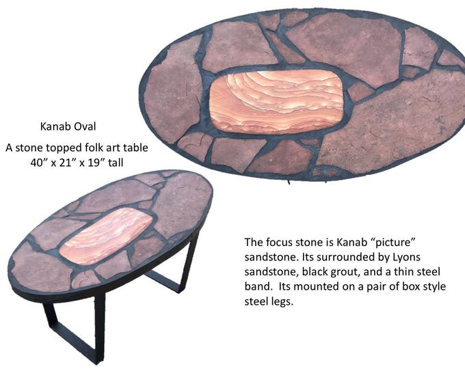 "Kanab Oval: A natural stone topped folk art coffee table 40"" x 21"" by 19"" tall"