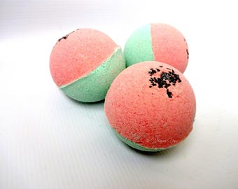 Summer Melon Bath Bomb made with organic shea butter, avocado oil, epsom salts, and colloidal oatmeal.