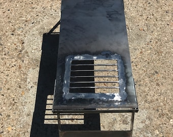 Camping hot plate with built in bbq grill.