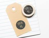 Rubber stamp 'open me', text stamp, postal stamps, stationery, craft supplies, snail mail, pen pals, gift wrapping ideas, diy packaging