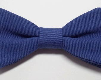 Royal blue bow sewn by hand with straight edges