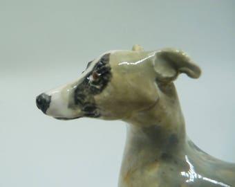 Miniature porcelain whippet sculpture