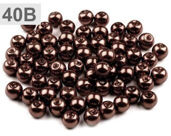 B 40-50 g of round 6 mm glass pearl beads
