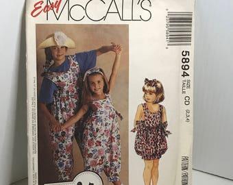 D182 McCall's 5894,sewing pattern, girls romper, jumper,jumpsuit,headband , size 2-4  uncut