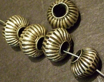 One Vintage Thai Hill Tribe silver leaf resin beads, no longer being made.  9x14 mm, 4.5 mm hole (Pkt 74)