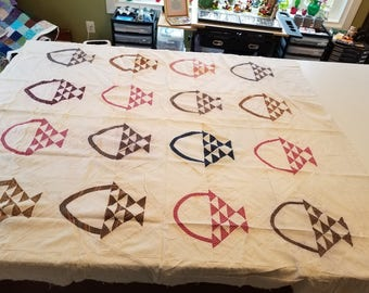 Vintage multicolored baskets quilt topper