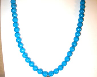 Blue beads and a pendant necklace