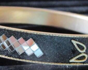 "vintage goldtone metal bangle black outside silvertone designs 9""long x 1/2"""