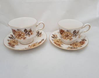 Vintage//Queen Anne bone China tea cups and saucers england////Golden edge//beautiful flowers//high tea//man and woman