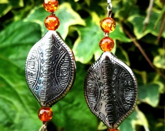 Radiant strength tribal earrings.