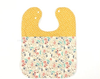 Large baby or toddler bib. Beige cotton with flowers. Yellow cotton with triangles. White terry cotton back. Baby shower gift.