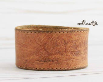 CUSTOM HANDSTAMPED distressed brown leather cuff with stitching by mothercuffer