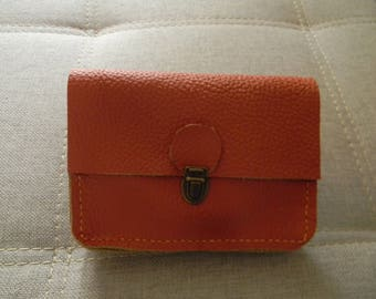 Orange leather clutch with loop for belt