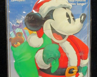 Dico Disc.   Mickey's Christmas C D.  Mint Condition, never used or displayed, in the box  1680a