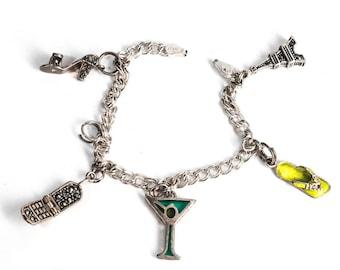 sterling charm bracelet w/enamel, marcasite & plique a jour charms