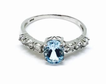 Bluetopaz and white topaz ring  set in Sterling silver 925. Size -9. Natural authentic stones.