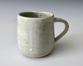 Modern handmade pottery coffee cup/mug matte white over black clay Haight Pottery Company
