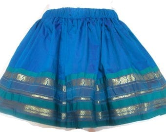 Girl in Indian fabric skirt