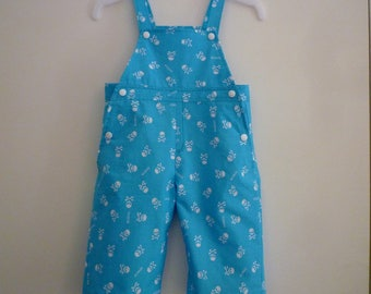 Baby blue and white sugar skulls, overall size 9-12 months
