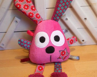 The toy Fuchsia - rattle - educational toy