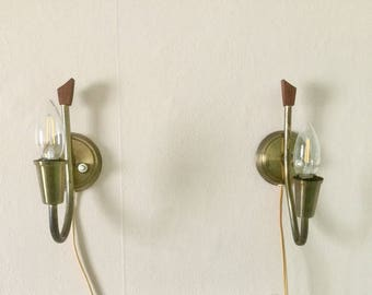 Danish mid-century modern brass plated wall lights with teak accents. Danish design. Retro Scandinavian lamps.