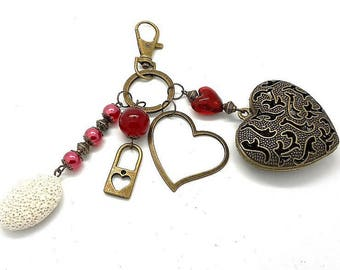 A scent! bronze bag charm, heart and red tones pink beads