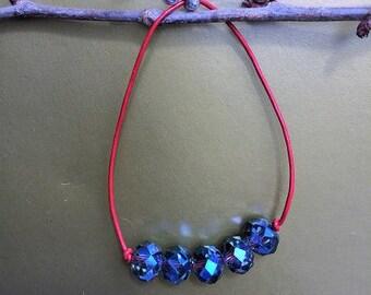 Blue Swarovski on leather strap and 925 Silver Pearl Beads Bracelet
