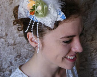 Bibi /Chapeau blue and green for the bride or bridesmaid with white lace and feathers