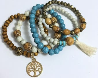 Set of five bracelets; Wood & others
