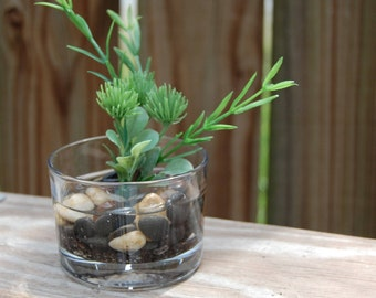 Assorted Faux Greenery with Evergreen in Small Cylinder Glass with Stones and Artificial Water