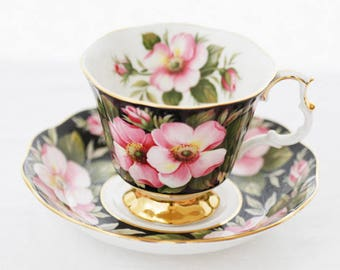 """Royal Albert Provincial Flowers Series """"Alberta Rose"""" black chintz teacup, saucer decorated with pale pink Roses"""