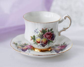 PARAGON by appointment to Her Majesty small teacup and saucer,delicate fruit dessin, goldgilt rims and foot, 1970