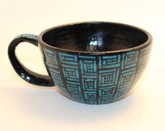 Teal and black teacup