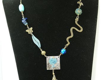 riveted metal stamping necklace bronze antique tree snake, flowers, brass, beads