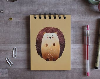 NOTEPAD. A6 Cute Hedgehog Spiral Notepad. Soft 300 gsm Card Cover. 120 blank pages. Matte lamination pleasant to the touch.