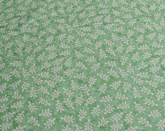 Cream Christmas Trees on Green Cotton Fabric
