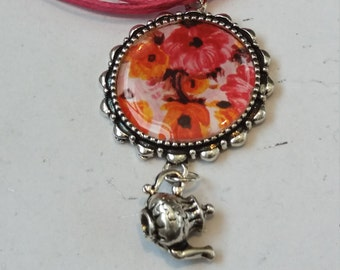 Vibrant pink ribbon flower cabochon charm necklace
