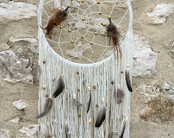 Dream catcher made of wool and natural feathers