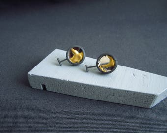 Oxidised T time recovery studs. Kintsugi repaired mirror set in recycled silver
