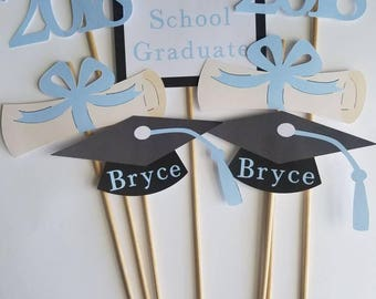 7 piece 2018 graduation centerpiece customized with graduate name on graduation cap and school name and colors. Graduation party decor