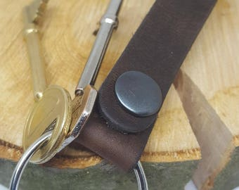 Handmade Leather Keyring, with stud fastening to clip onto belt or bag. Moustache logo stamped onto the front. Great Christmas gift for him